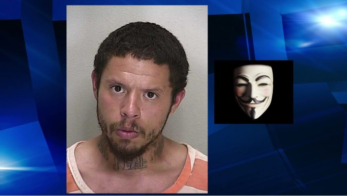 Man arrested for wearing Guy Fawkes mask