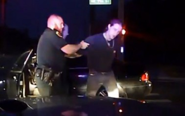 Drunk fell asleep at traffic light; pulled gun on deputy
