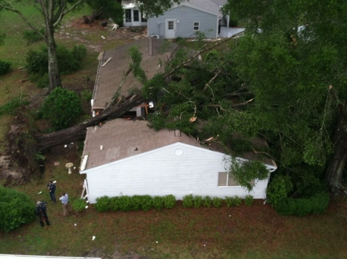 A tornado and fallen trees caused major damage to homes