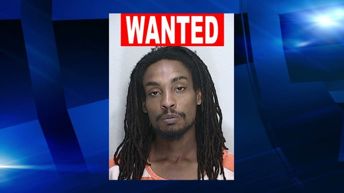 OPD: Man wanted after he beat woman in street