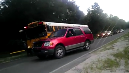Firefighter who drove around stopped school bus will be ticketed