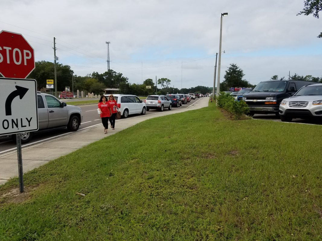 Vehicles waiting to enter the parking area for the Trump rally, 9:40 a.m.