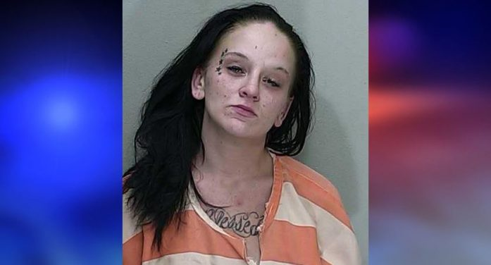 Deputy witnesses woman attack another female, children present