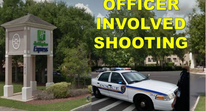 Man dead following officer involved shooting at hotel