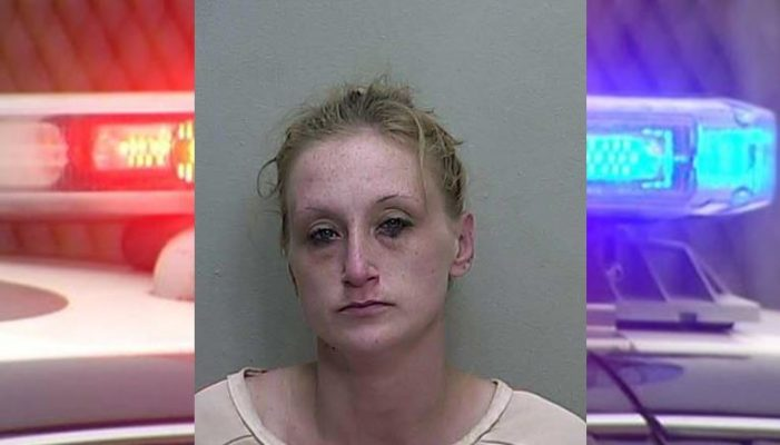 Woman confronted juveniles with pipe, arrested