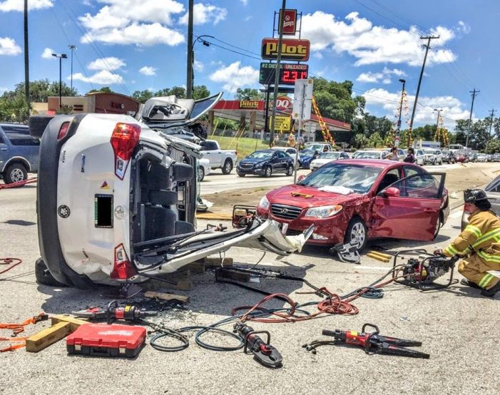 Two people cut from vehicle following 484 crash