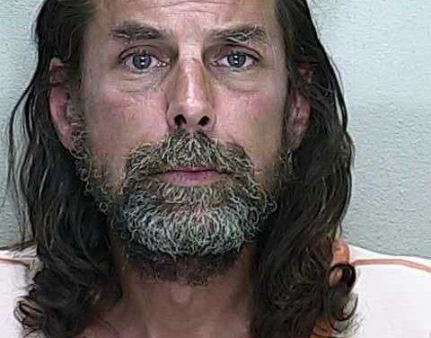 Man arrested after burning two American flags