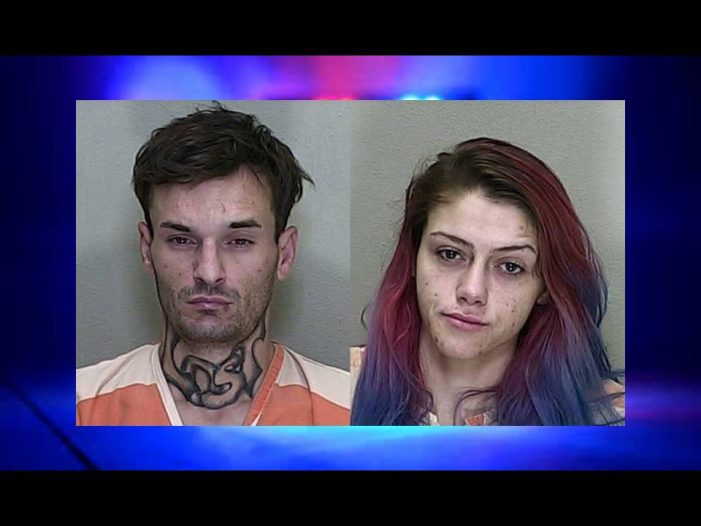 Two people found passed out in vehicle parked at gas pumps