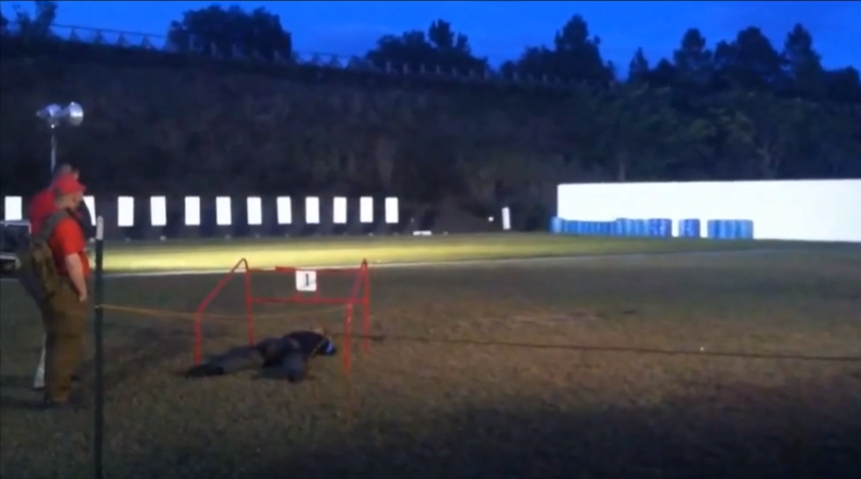 Corporal David Woolf makes a 50 yard shot with a pistol.