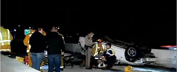 Firefighter placed in handcuffs while tending to accident victims