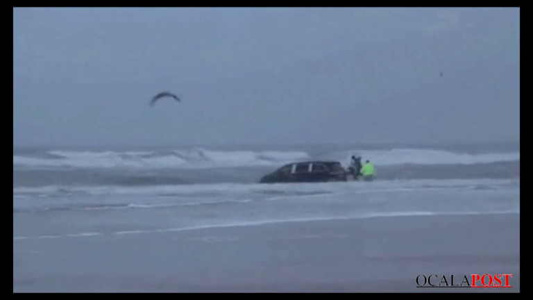 Pregnant woman drives into the ocean with kids strapped in