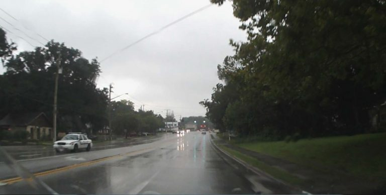 Rain: Drive with your headlights on, it's the law