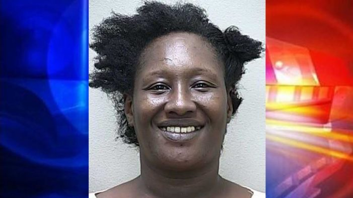 Woman arrested for hitting juveniles with a cooking pot