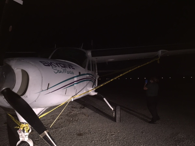 Man pulled from airplane while in flight, dies