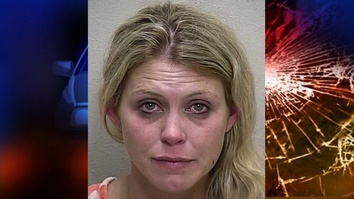 Woman arrested after witnesses pulled her from an overturned vehicle
