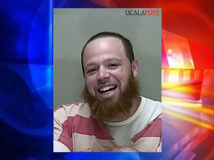 Attempted murder suspect smiles for his booking photo