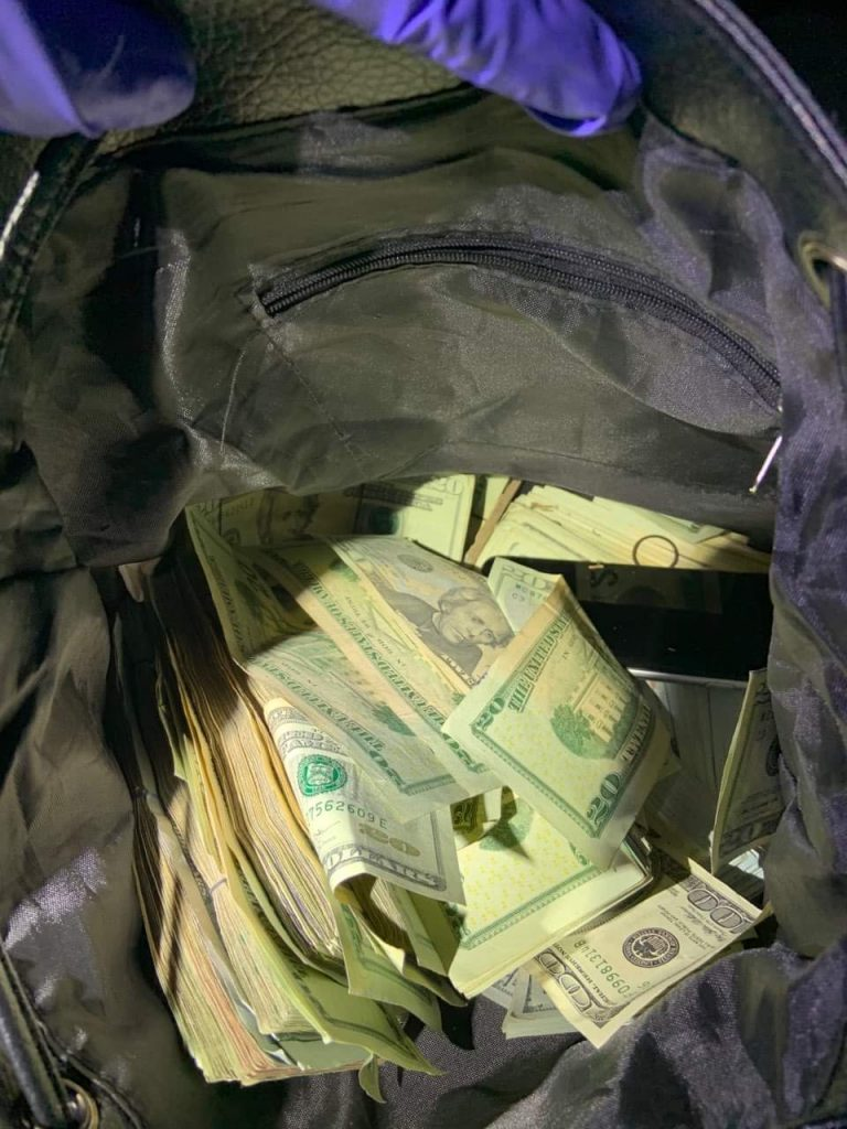 Police discover bag full of cash and drugs, searching for owner
