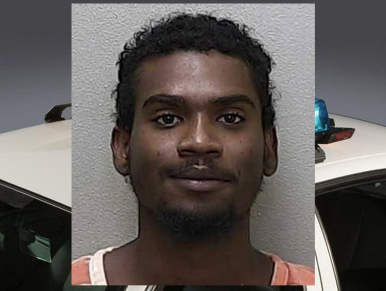 Man allegedly pointed gun at officer before fleeing the scene